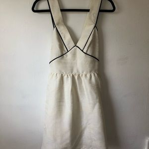 Off white dress with black detailed trim
